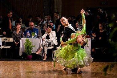 Man and Woman dancing before judges