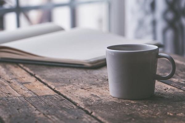 Coffee mug and book